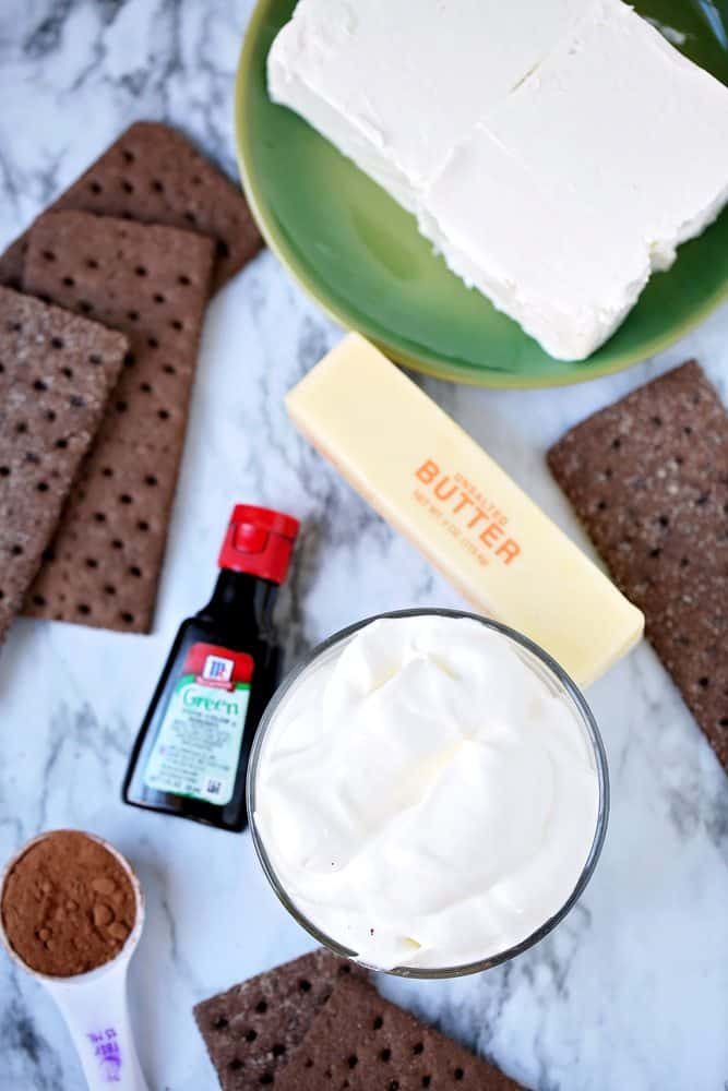 chocolate graham crackers, cream cheese, butter, powdered sugar, whipped topping, green food coloring, cocoa powder