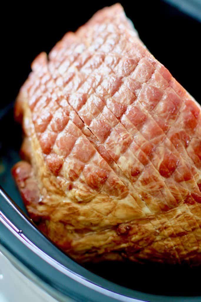 spiral sliced ham in an oval 8-quart slow cooker