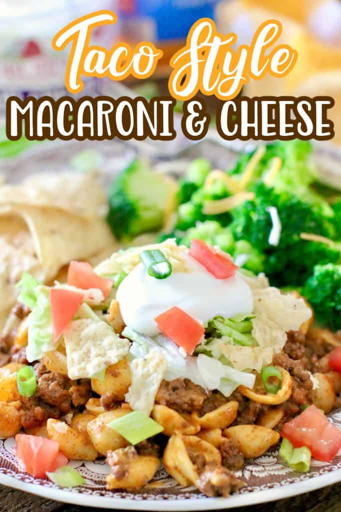 Easy Taco Macaroni and Cheese recipe shown served on a plate with steamed broccoli and tortilla chips