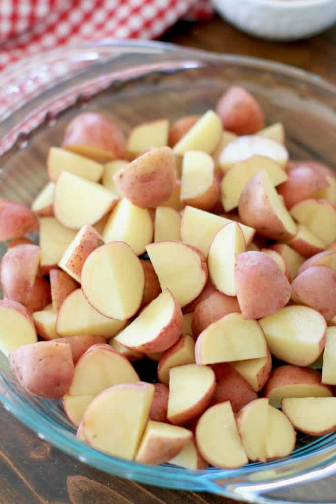 diced little potatoes in a round glass pie pan