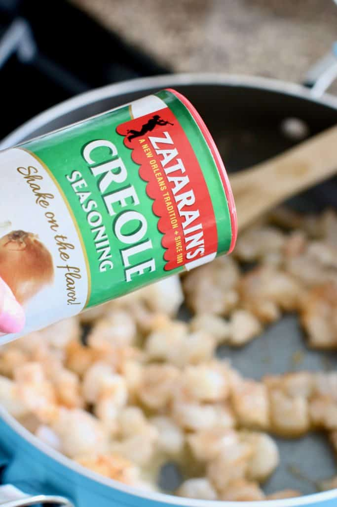 seasoning shrimp with Zatarain's Creole Seasoning