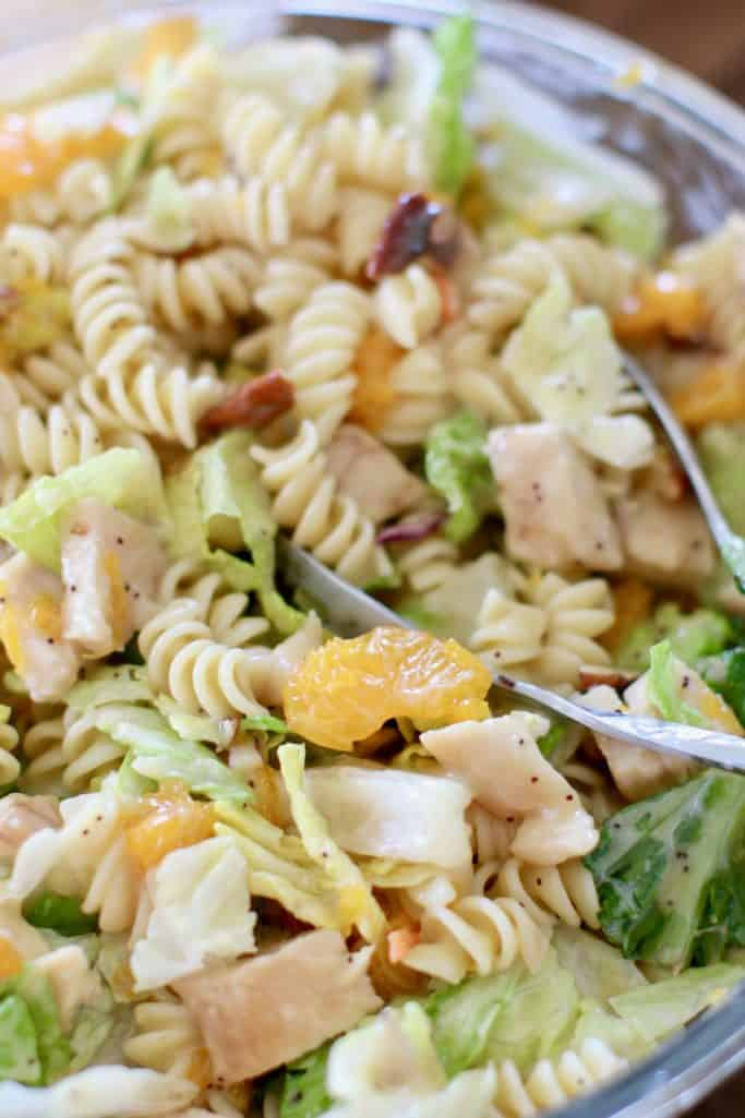 pasta stirred together with lettuce, mandarin oranges, grilled chicken and poppyseed dressing