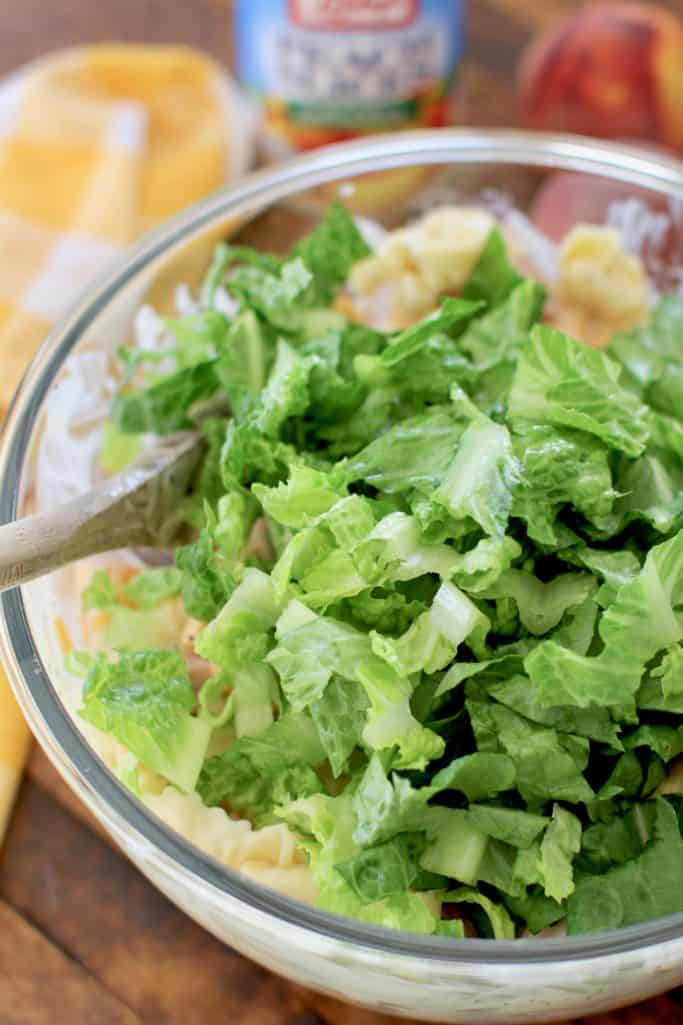 chopped romaine lettuce in large, clear Pyrex bowl