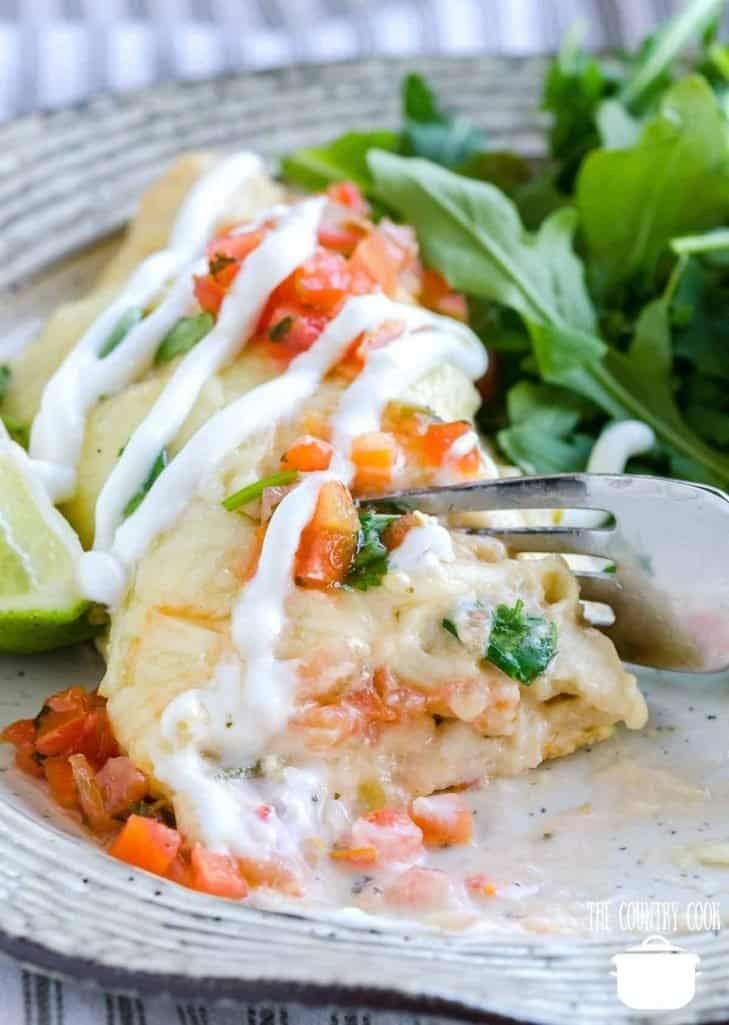 Shrimp Enchiladas with cream sauce and pico de gallo