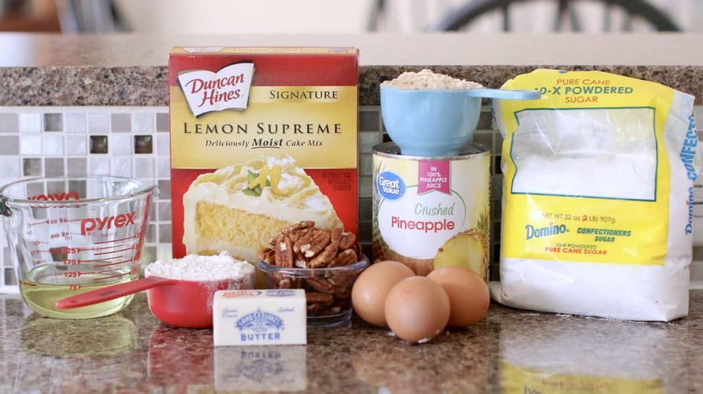 Lemon cake mix, crushed pineapple, brown sugar, eggs, butter, flour, powdered sugar, pecans