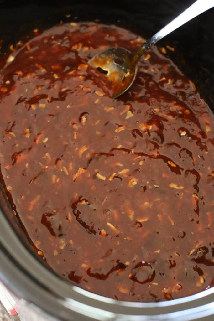 BBQ sauce, apricot jam and onion soup mix stirred together in a KitchenAid 5 quart crock pot