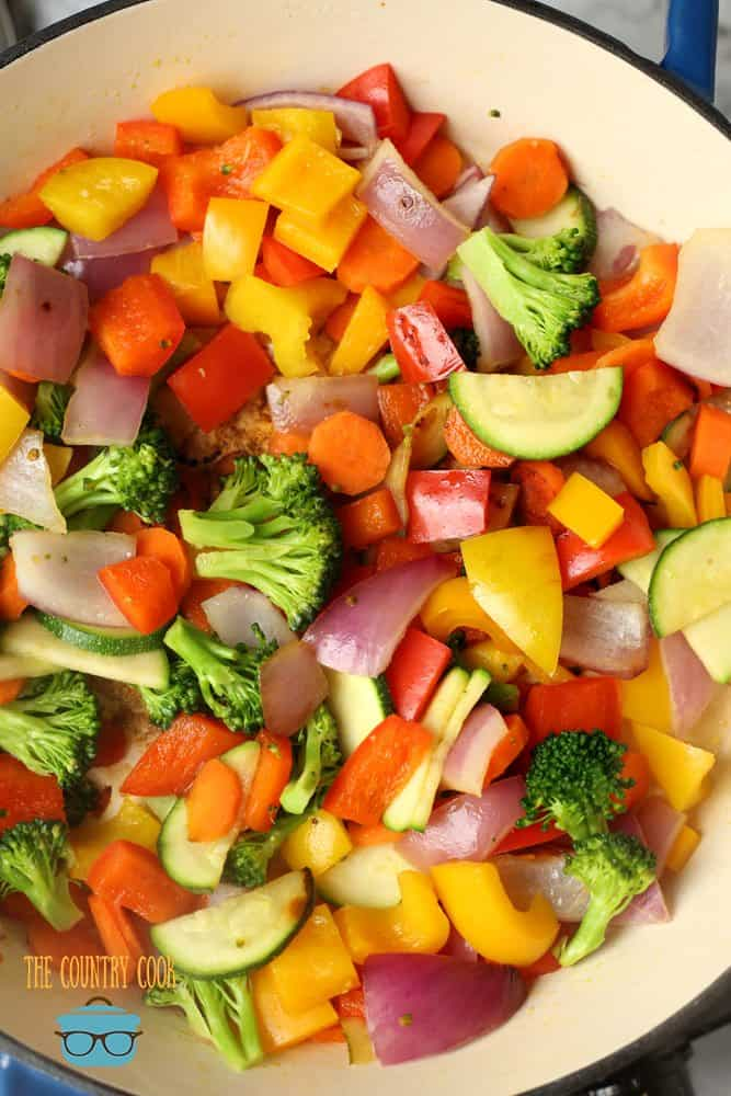 chopped vegetables sautéed in a skillet