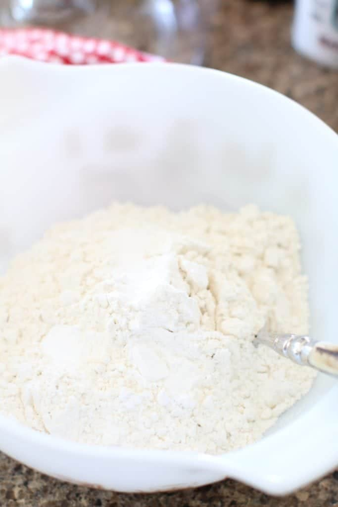 all purpose flour, baking powder and salt mixed together with a fork in a bowl