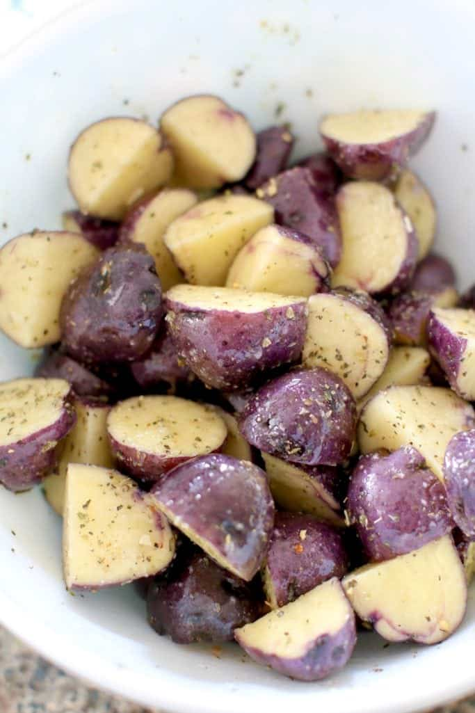 melted butter coated little potatoes with garlic salt and Italian seasoning