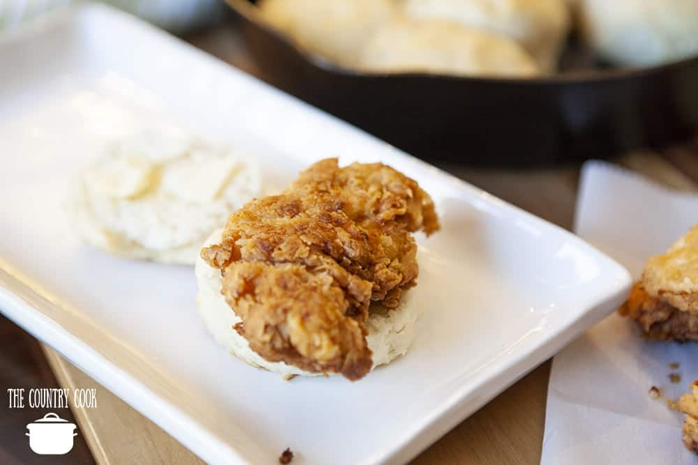 fried chicken tender on a warm homemade soft biscuit