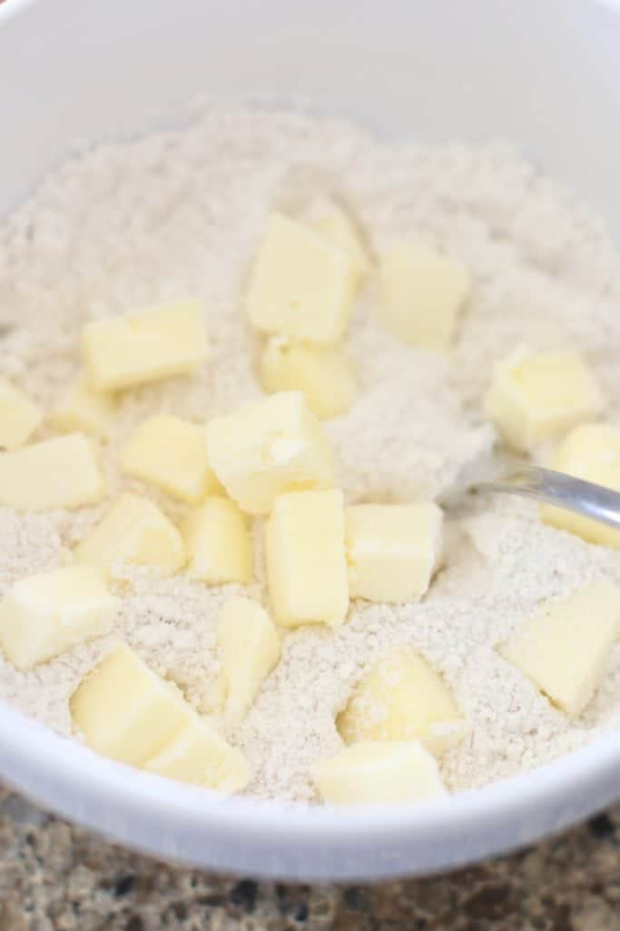 salted cubed butter added to flour, sugar and cinnamon mixture