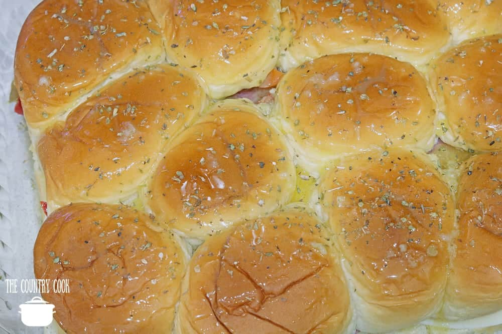 Hawaiian sweet rolls topped with melted butter and dried oregano