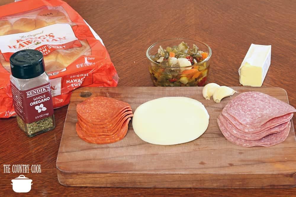 King's Hawaiian Sweet Rolls, sliced pepperoni, sliced salami, provolone cheese, giardianera, salted butter, garlic, oregano