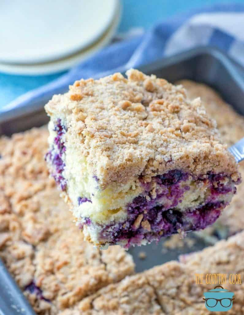 Blueberry Buckle Cake cut into 12 slices in a baking pan