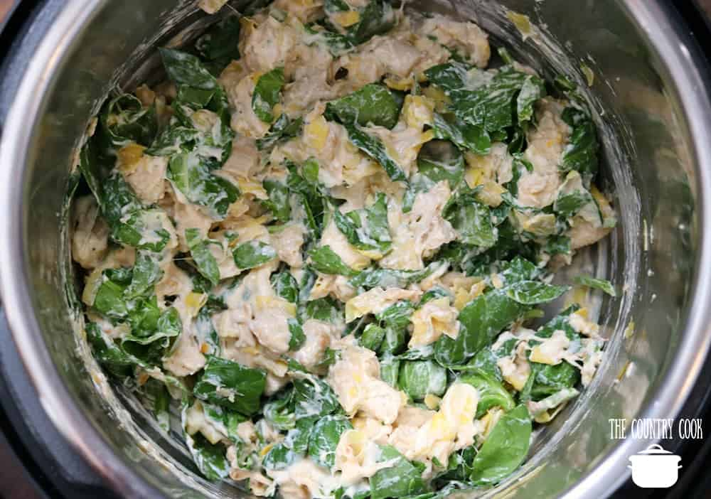 heavy cream, cream cheese, Parmesan cheese, mozzarella cheese mixed together with chopped spinach and artichoke hearts