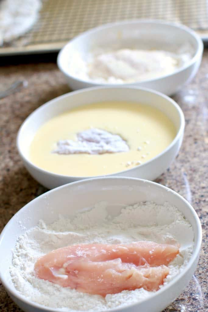 coating chicken breasts in three dips