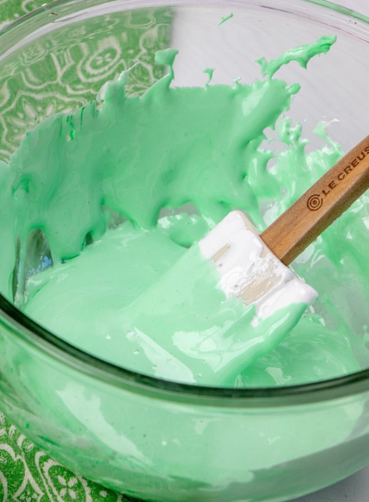 green food coloring, marshmallow fluff and mint extract combined