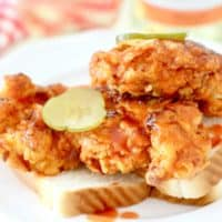 mild version of Nashville Hot Chicken with sliced pickles and sliced white bread