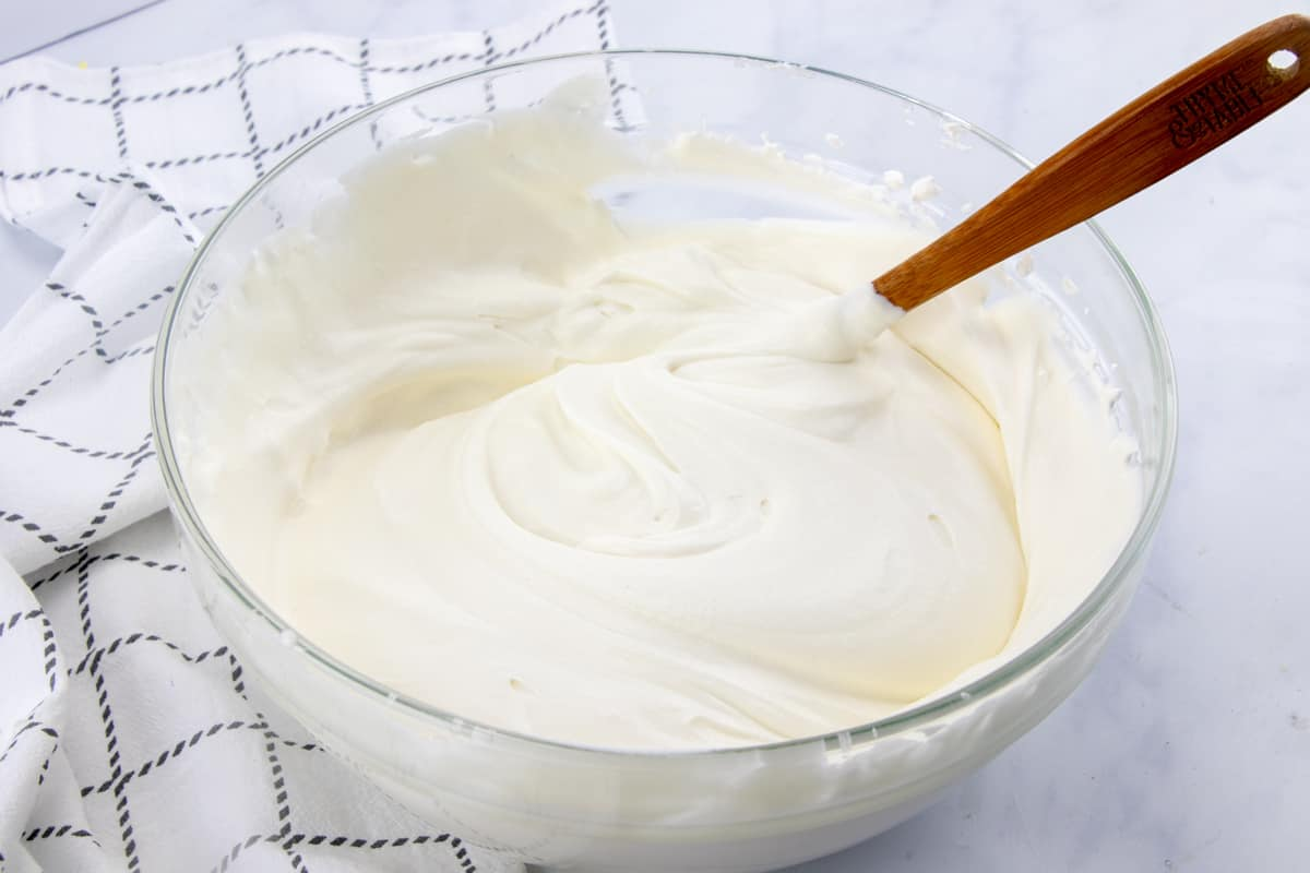 whipped cream and sweetened condensed milk stirred together in a large bowl