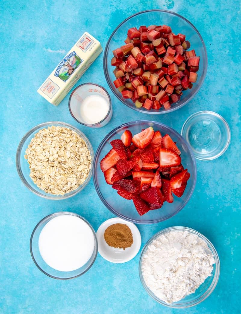 ingredients needed to make strawberry rhubarb cobbler/crisp: rhubarb, strawberries, cornstarch, all-purpose flour, rolled oats, sugar, cinnamon, water, salted butter.
