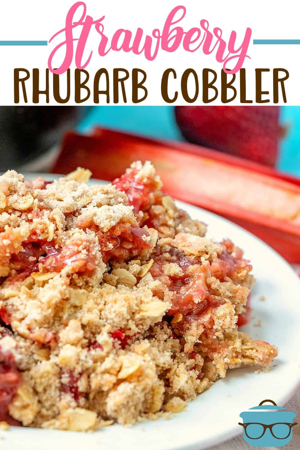 Strawberry Rhubarb Cobbler recipe from The Country Cook. Closeup photo of strawberry rhubarb cobbler serving on a white round plate.