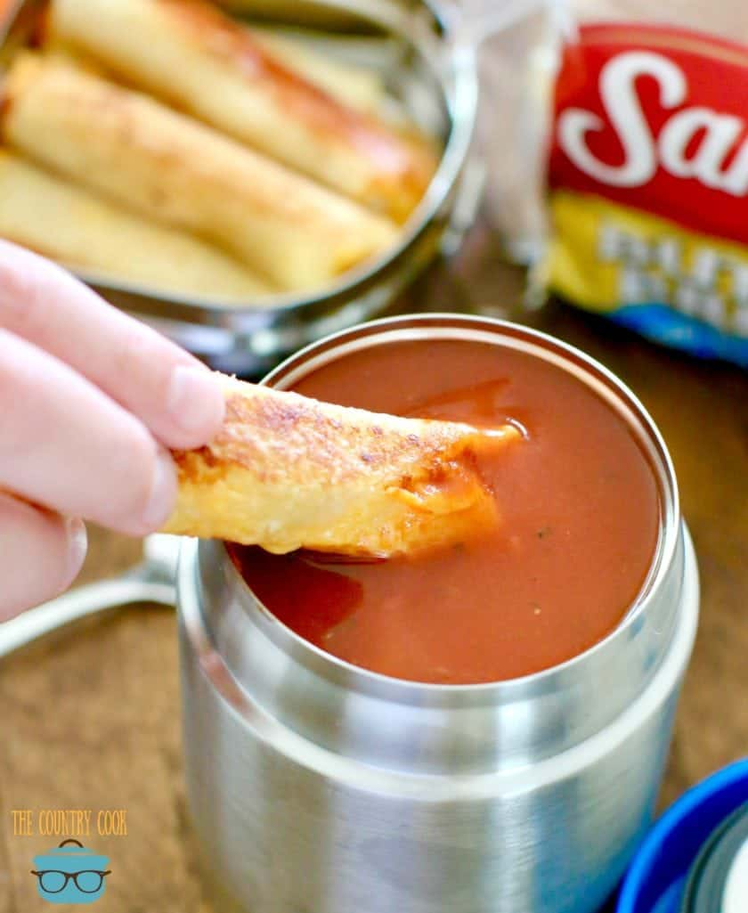 dipping grilled cheese into thermos of tomato soup, back to school kid lunch ideas