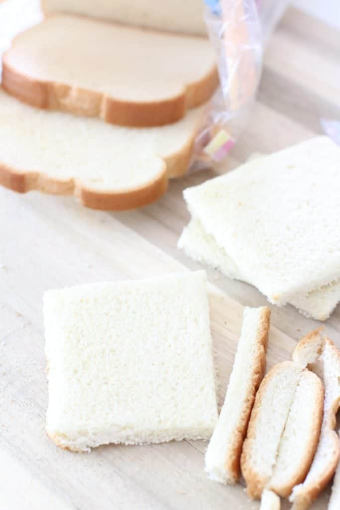 removing crusts from bread