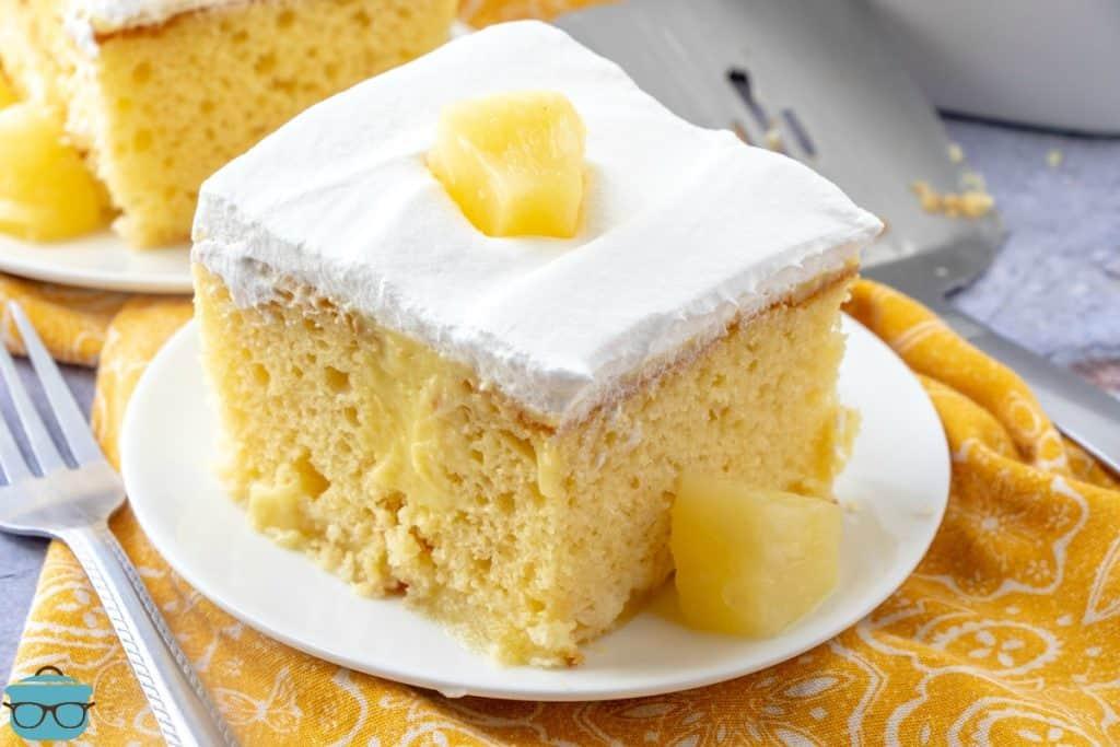 slice, Pineapple Pudding Poke Cake on a white plate