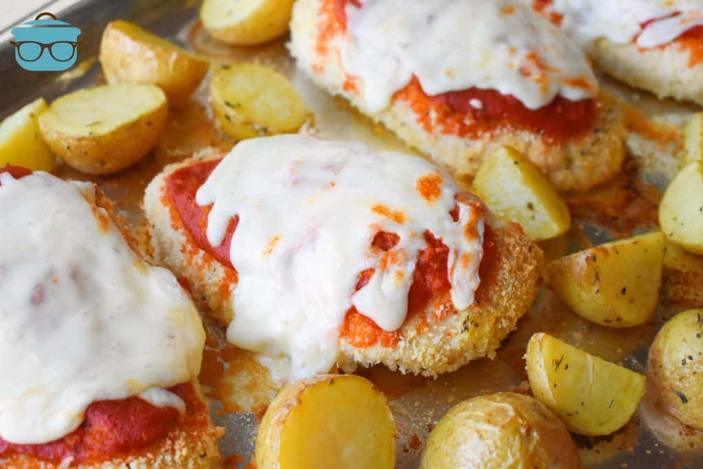 Sheet Pan Chicken Parmesan and Potatoes on aluminum foil covered baking sheet