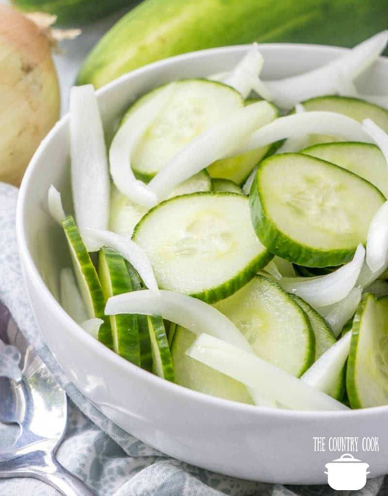 sliced cucumbers and onion in onion in a bowl