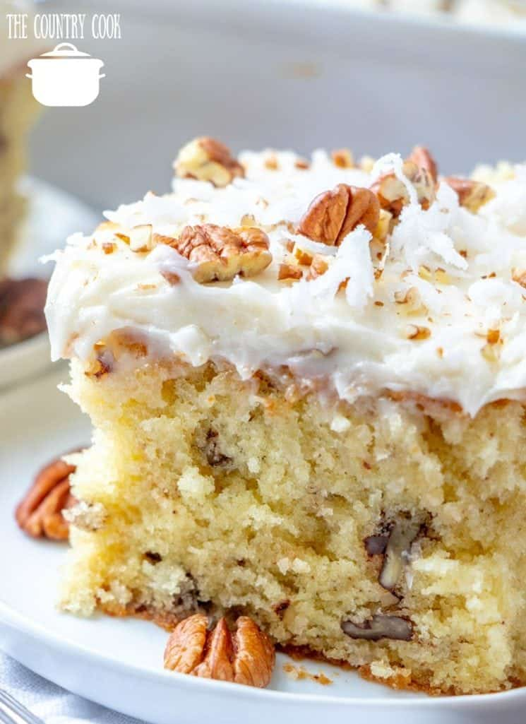 Homemade Italian Buttermilk Cream Cake slice on a white plate with chopped pecans