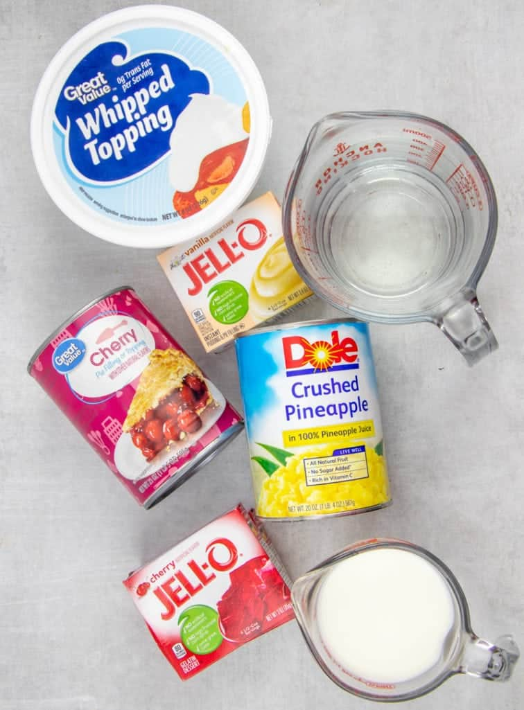 cherry pie filling, cherry gelatin, crushed pineapple, milk, instant vanilla pudding, water, whipped topping