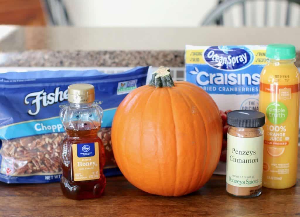 pie (sugar) pumpkin, chopped pecans, dried cranberries (craisins), honey, cinnamon, orange juice