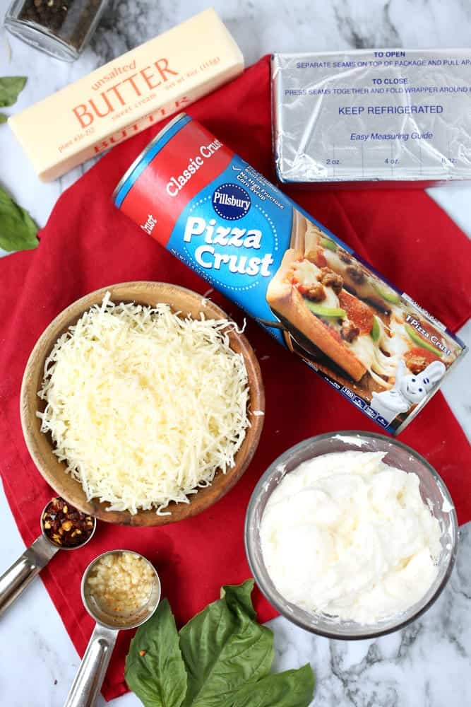 refrigerated pizza crust, cream cheese, mozzarella cheese, sour cream, garlic basil, butter
