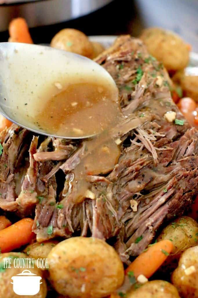 thickened beef gravy poured over beef pot roast made in the Instant Pot