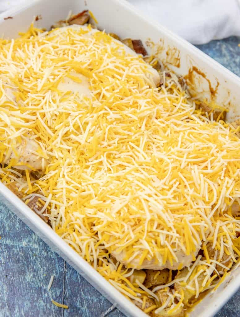 shredded cheddar cheese on chicken and potatoes