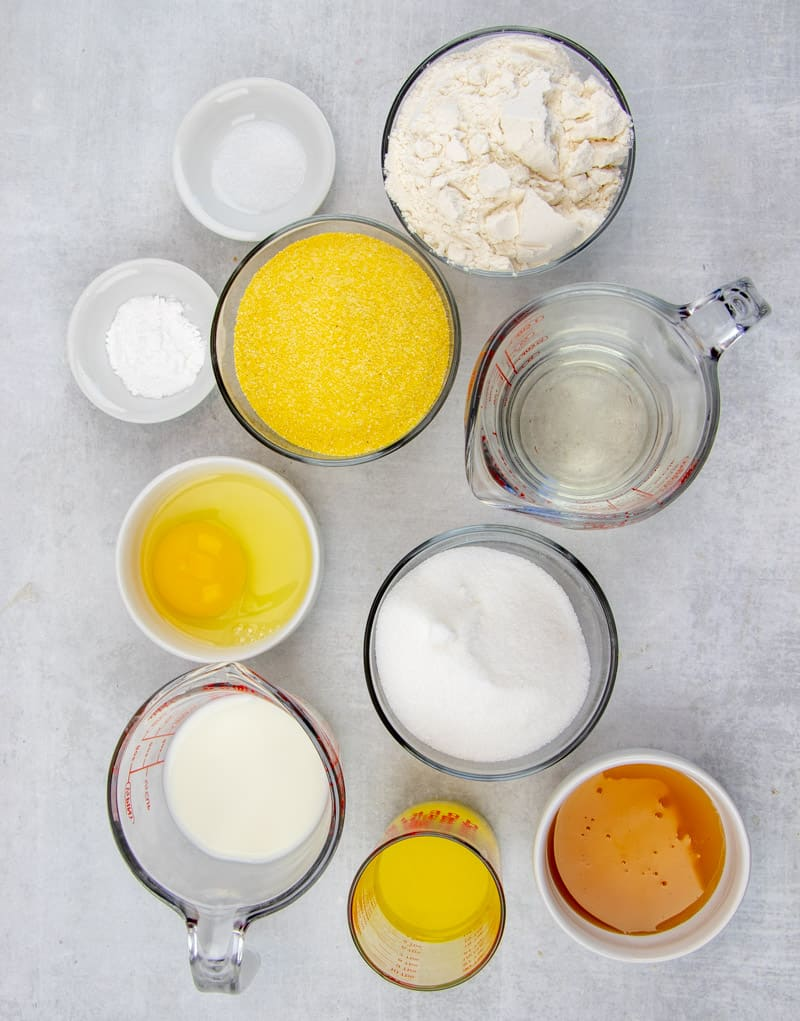 honey, egg, butter, milk, water, sugar, yellow corn meal, all-purpose flour, baking powder, salt