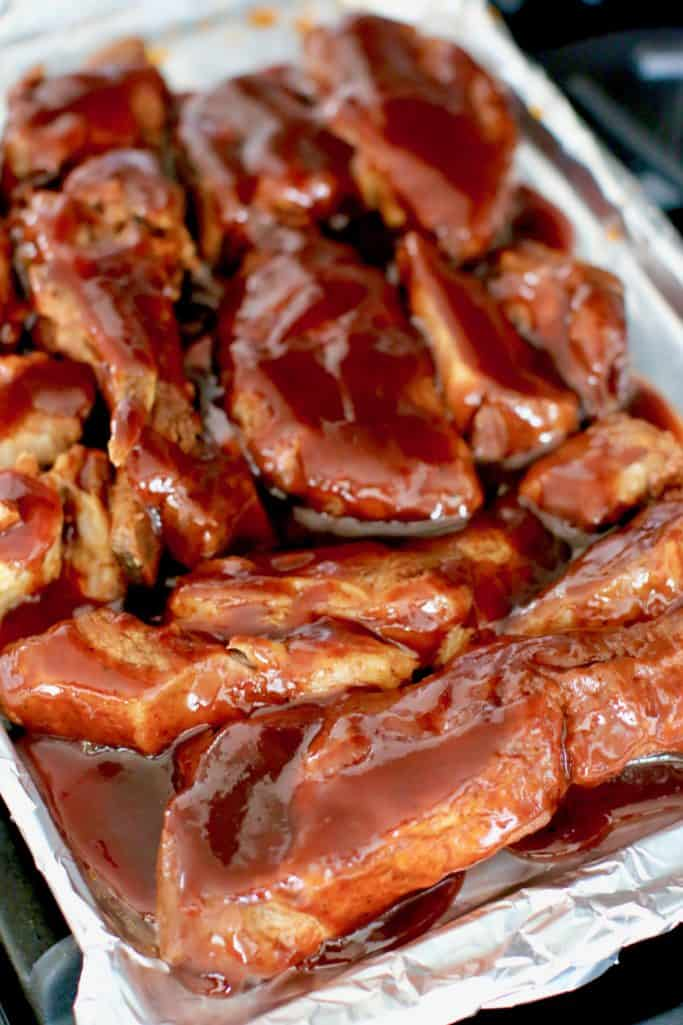 Korean BBQ sauce poured over cooked country style ribs