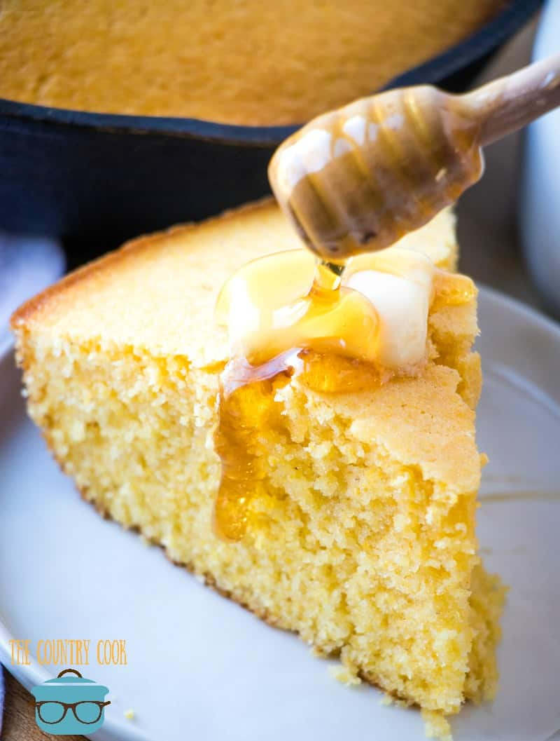 skillet cornbread, topped with butter and drizzled with real honey