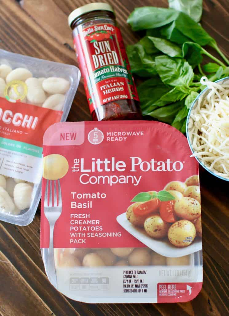 Tomato Basil Little Potatoes, packaged potato gnocchi, fresh basil, shredded mozarella, jarred sun dried tomatoes in olive oil and Italian herbs