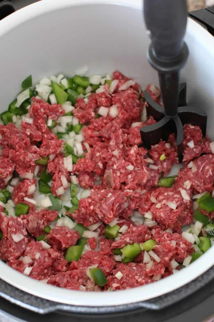 browning ground beef, onion, green pepper in an 8-quart pressure cooker