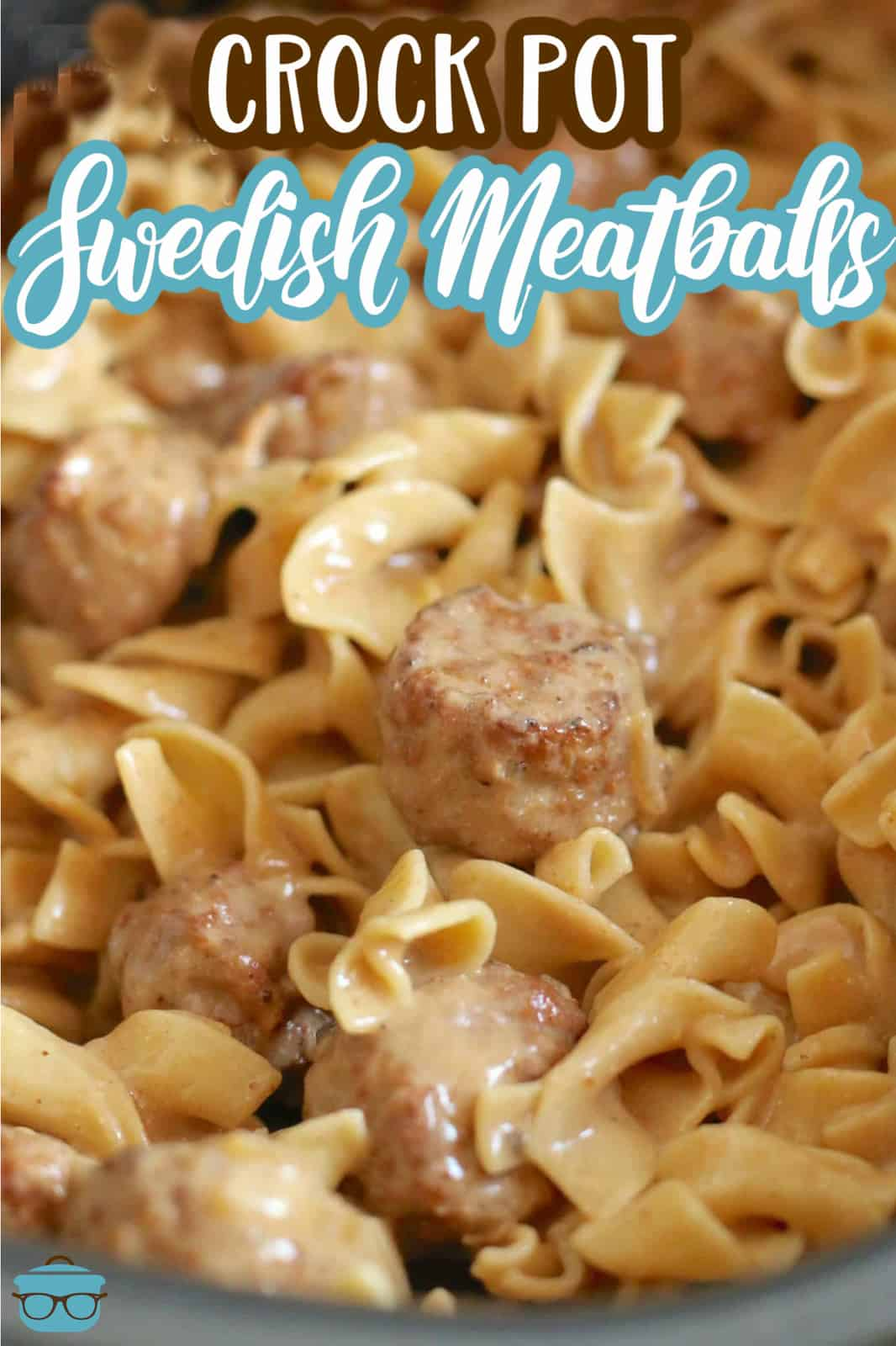 Swedish Meatballs with cooked egg noodles combined and shown in an oval slow cooker