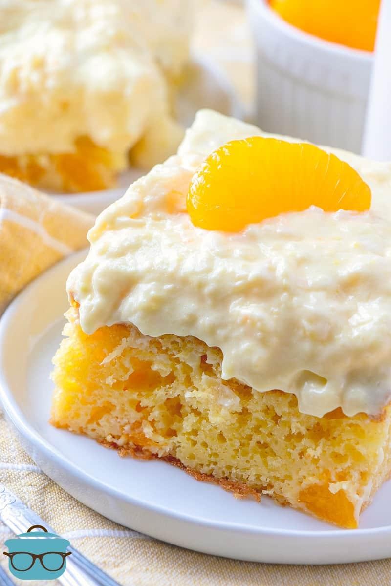 slice of mandarin orange cake on a white plate