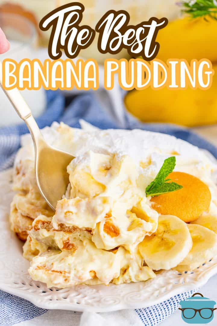 The Best Banana Pudding recipe from The Country Cook, serving of banana pudding on a small white plate with a spoon inserted into pudding