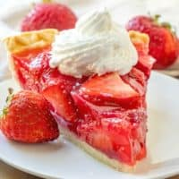 slice, Shoney's Strawberry Jell-o Pie on a white plate topped with whipped cream