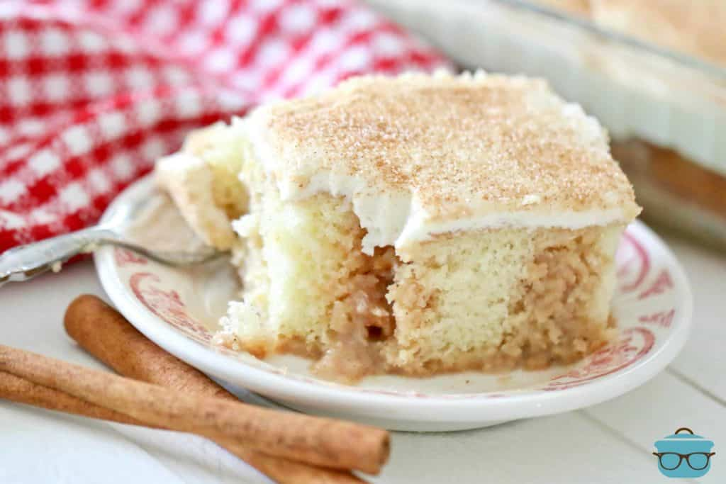 slice, Cinnamon Roll Poke Cake with cream cheese frosting