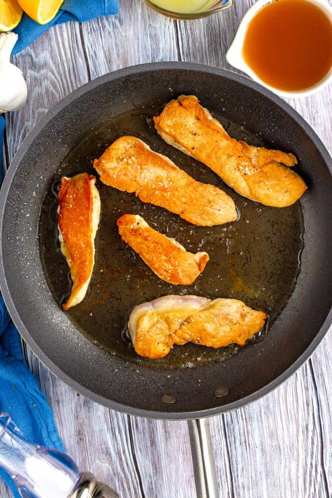 browning chicken in a hot pan with oil