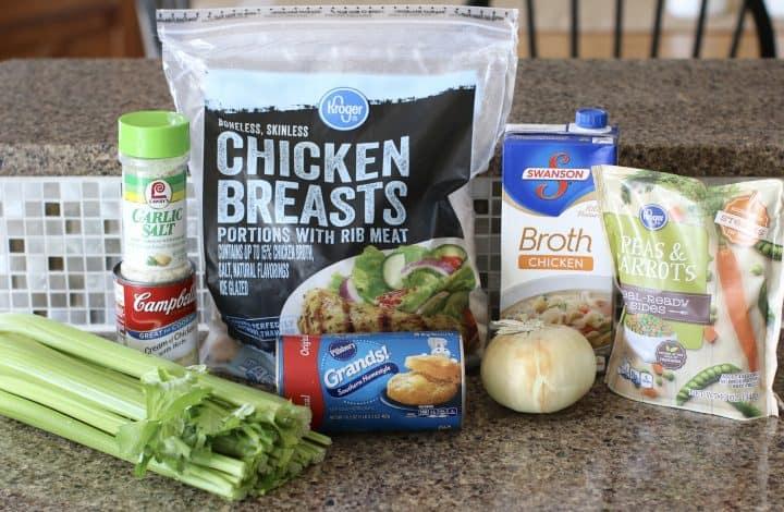 ingredients needed: chicken broth, cream of chicken soup with herbs, onion, celery, chicken breasts, garlic salt, black pepper, frozen peas and carrots, all purpose flour, Pillsbury Grands Biscuits