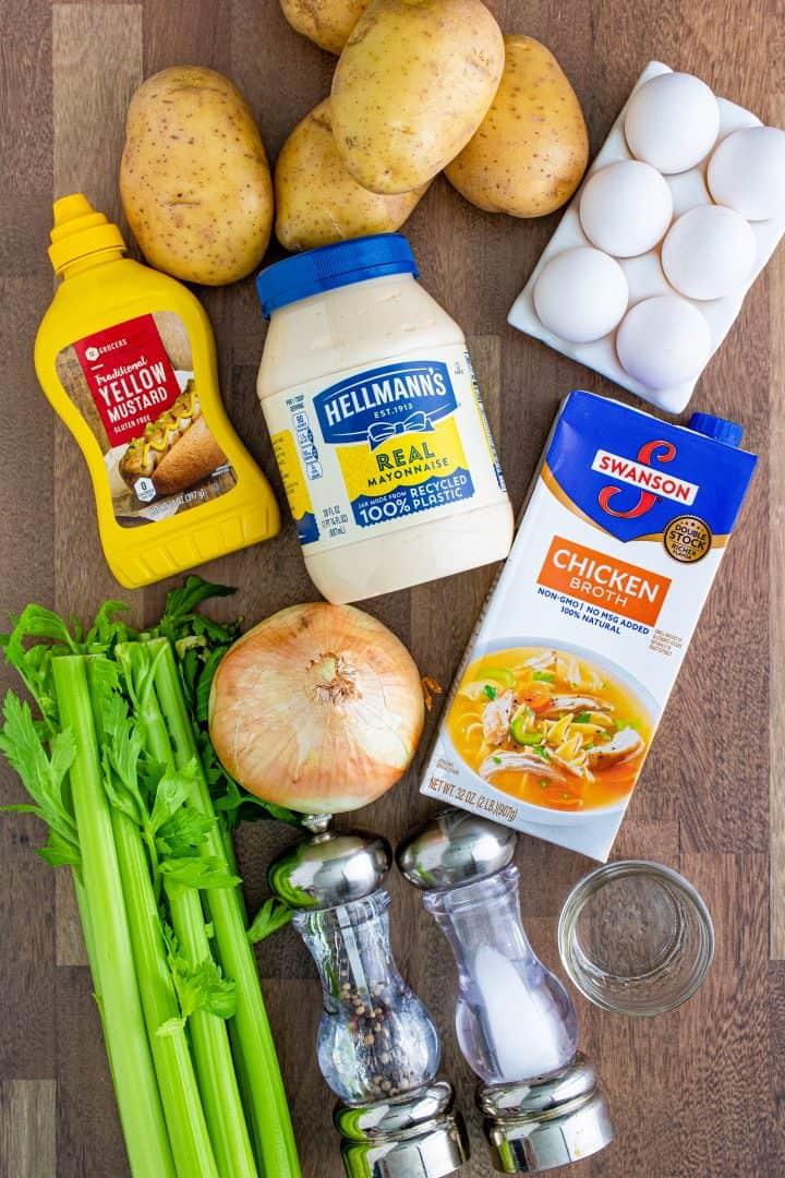 potato salad ingredients shown: Yukon gold potatoes, mayonnaise, white vinegar, yellow mustard, chicken stock, salt, pepper, celery, onion, hard boiled eggs.