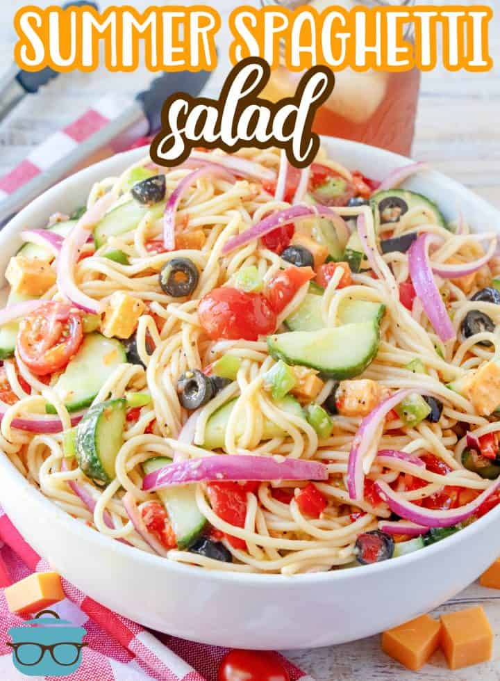 Summer Spaghetti Salad recipe from The Country Cook, salad shown in a large white serving bowl with glass of sweet train the background